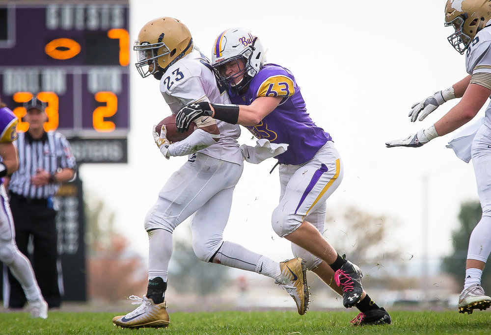 Williamsville's Zeke Kern (63) brings down Bloomington Central Catholic's Sa'mond Davis (23) on a rush in the second quarter during the second round of the IHSA Class 3A Playoffs at Paul Jenkins Field, Saturday, Nov. 4, 2017, in Williamsville, Ill. [Justin L. Fowler/The State Journal-Register]