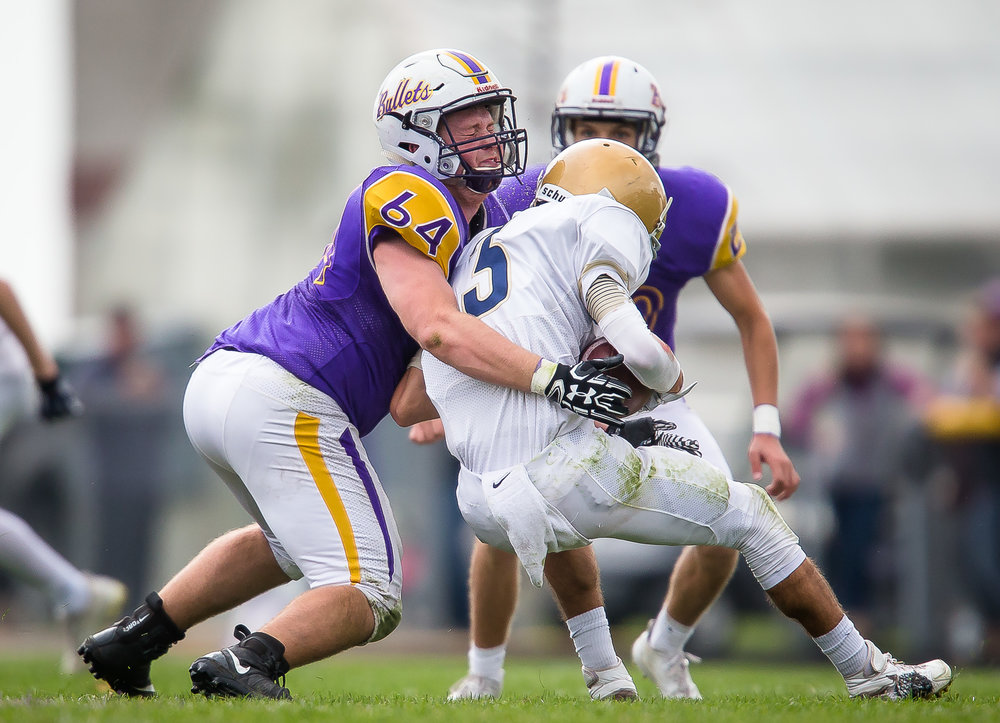 Williamsville's Dylan McCafferty (64) puts a hit on Bloomington Central Catholic's Austyn Ellison (3) to bring hime down on a rush in the second quarter during the second round of the IHSA Class 3A Playoffs at Paul Jenkins Field, Saturday, Nov. 4, 2017, in Williamsville, Ill. [Justin L. Fowler/The State Journal-Register]