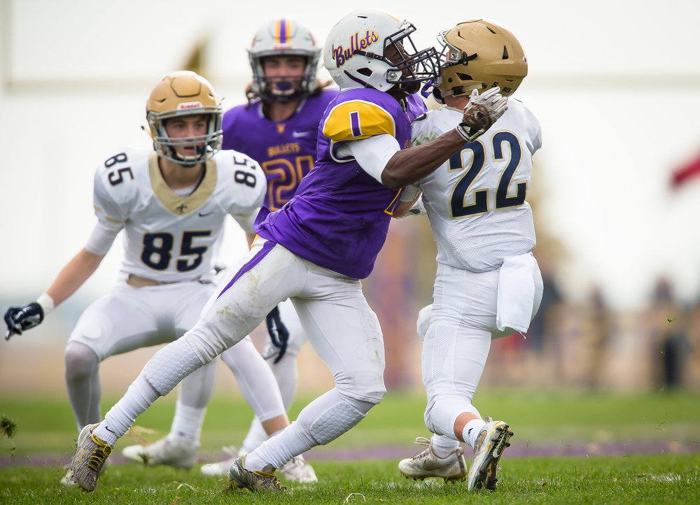 Williamsville's Daetayvian Woodson (1) puts a big hit on Bloomington Central Catholic's Reece Seidl (22) to bring hime down on a a rush in the second quarter during the second round of the IHSA Class 3A Playoffs at Paul Jenkins Field, Saturday, Nov. 4, 2017, in Williamsville, Ill. [Justin L. Fowler/The State Journal-Register]