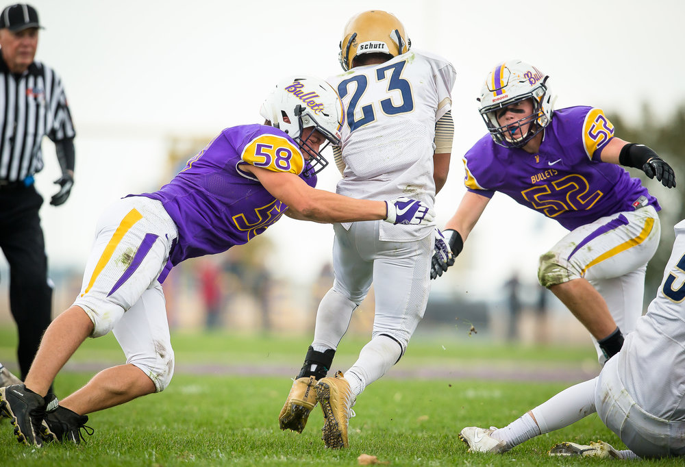 Williamsville's Ben Arnberger (58) and Williamsville's DJ Mumaw (52) collapse on Bloomington Central Catholic's Sa'mond Davis (23) to bring him down on a rush in the second quarter during the second round of the IHSA Class 3A Playoffs at Paul Jenkins Field, Saturday, Nov. 4, 2017, in Williamsville, Ill. [Justin L. Fowler/The State Journal-Register]