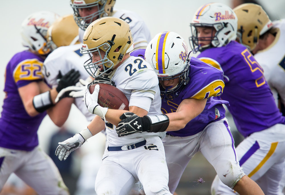 Williamsville's Zeke Kern (63) wraps up Bloomington Central Catholic's Reece Seidl (22) on a rush in the third quarter during the second round of the IHSA Class 3A Playoffs at Paul Jenkins Field, Saturday, Nov. 4, 2017, in Williamsville, Ill. [Justin L. Fowler/The State Journal-Register]