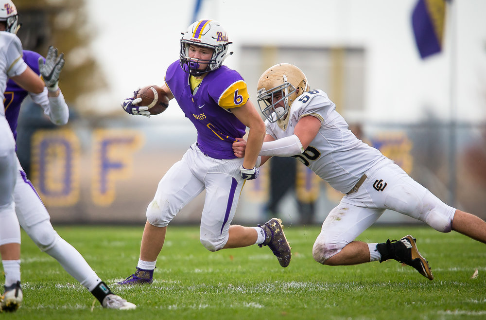 Williamsville's Grant Ripperda (6) is dragged down from behind by Bloomington Central Catholic's Patrick Rahuba (56) on a rush in the third quarter during the second round of the IHSA Class 3A Playoffs at Paul Jenkins Field, Saturday, Nov. 4, 2017, in Williamsville, Ill. [Justin L. Fowler/The State Journal-Register]
