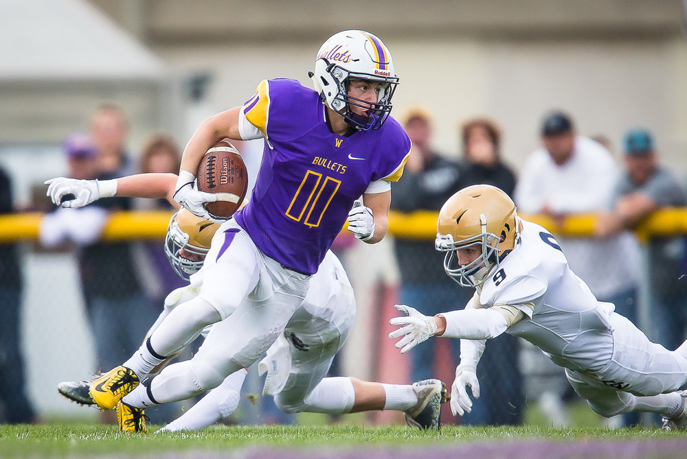 Williamsville's Hunter Thompson (11) cuts away from a tackle against Bloomington Central Catholic's Carson Kear (9) on his way to a 78-yard touchdown in the third quarter during the second round of the IHSA Class 3A Playoffs at Paul Jenkins Field, Saturday, Nov. 4, 2017, in Williamsville, Ill. [Justin L. Fowler/The State Journal-Register]