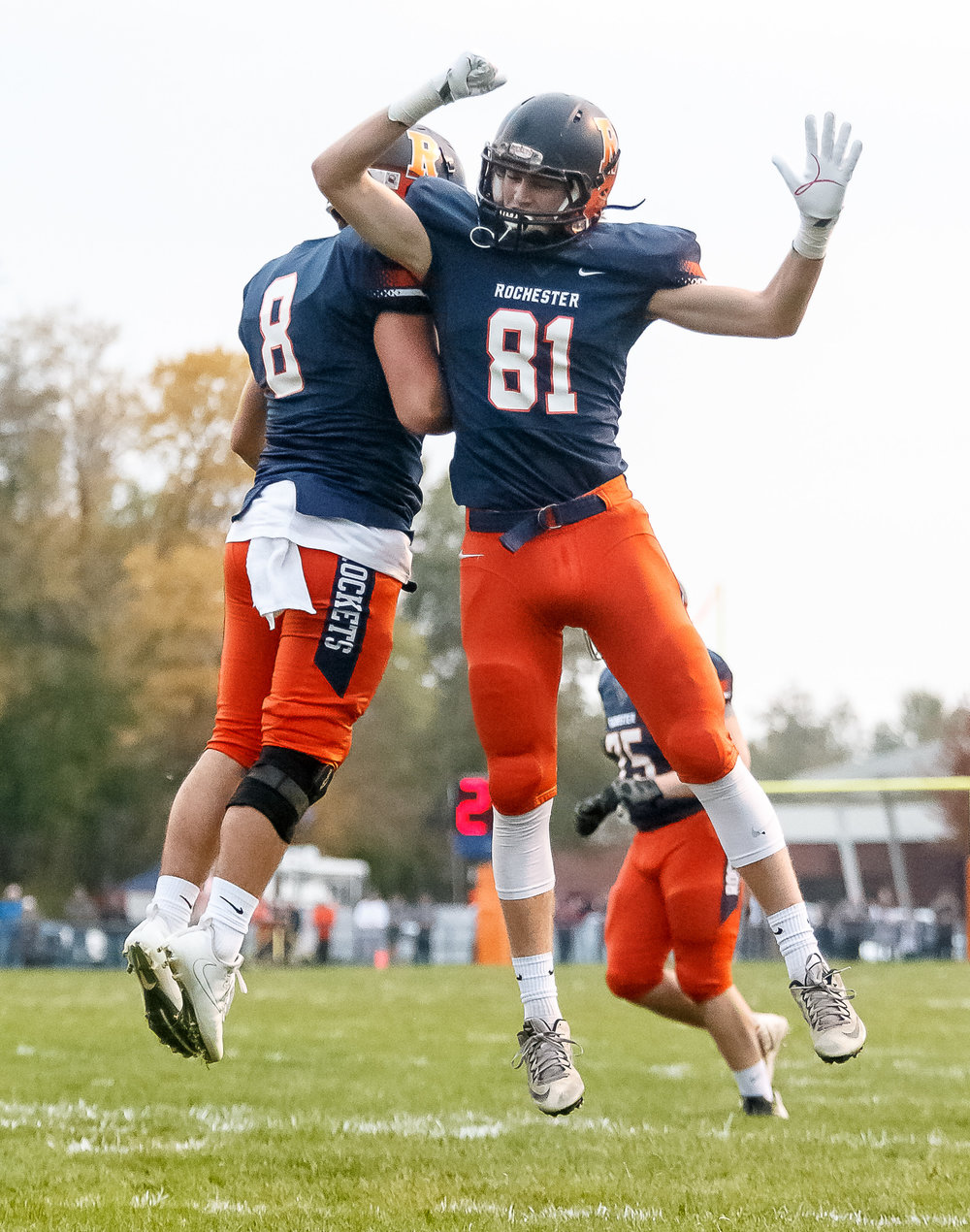 Rochester quarterback Nic Baker (8) celebrates his touchdown with Rochester's Jayden Reed (81) against Belleville Althoff in the first half during the second round of the IHSA Class 4A Playoffs at Rocket Booster Stadium, Saturday, Nov. 4, 2017, in Rochester, Ill. [Justin L. Fowler/The State Journal-Register]