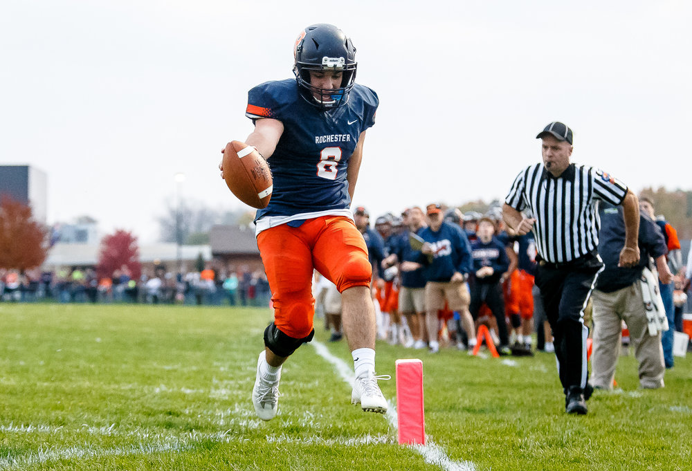 Rochester quarterback Nic Baker (8) goes in for a rushing touchdown untouched by Belleville Althoff in the first half during the second round of the IHSA Class 4A Playoffs at Rocket Booster Stadium, Saturday, Nov. 4, 2017, in Rochester, Ill. [Justin L. Fowler/The State Journal-Register]