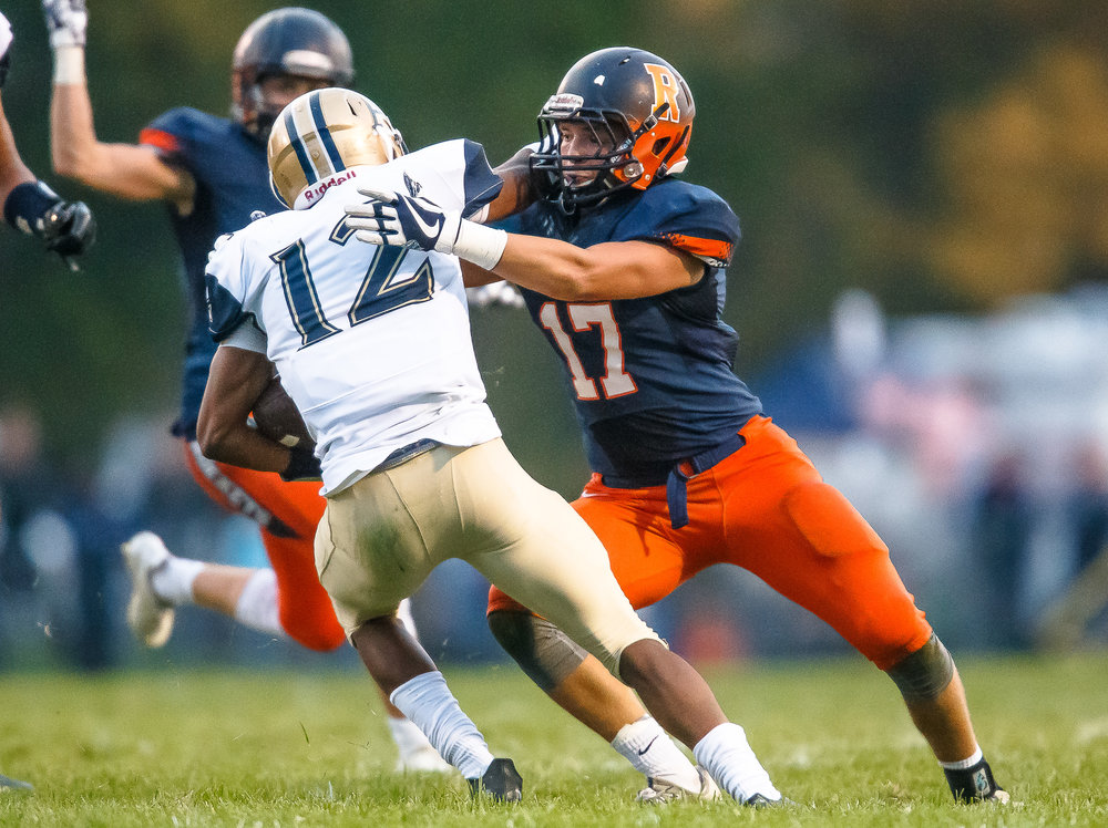 Rochester's Ben Chapman (17) wraps up Bellville Althoff's Melvin Brock (12) to bring him down a rush in the first half during the second round of the IHSA Class 4A Playoffs at Rocket Booster Stadium, Saturday, Nov. 4, 2017, in Rochester, Ill. [Justin L. Fowler/The State Journal-Register]