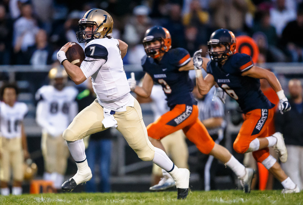Bellville Althoff quarterback Hayes Taylor (7) takes off on a touchdown run against Rochester in the first half during the second round of the IHSA Class 4A Playoffs at Rocket Booster Stadium, Saturday, Nov. 4, 2017, in Rochester, Ill. [Justin L. Fowler/The State Journal-Register]