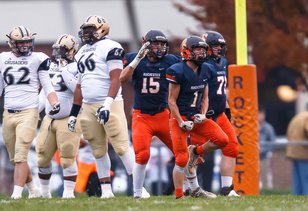 Rochester's Riley Lewis (1) is fired up after blocking an extra point kick against Bellville Althoff in the first half during the second round of the IHSA Class 4A Playoffs at Rocket Booster Stadium, Saturday, Nov. 4, 2017, in Rochester, Ill. [Justin L. Fowler/The State Journal-Register]