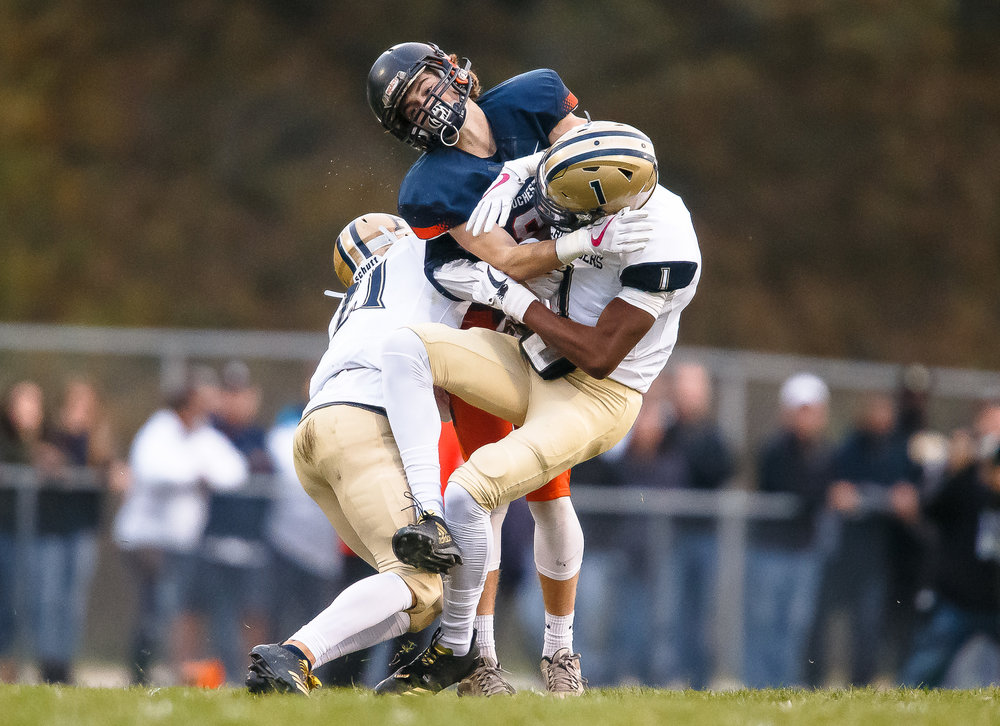 Rochester's Jayden Reed (81) gets sandwiched between Belleville Althoff's Iverson Brown (1) and Nick Alberico (21) in the first half during the second round of the IHSA Class 4A Playoffs at Rocket Booster Stadium, Saturday, Nov. 4, 2017, in Rochester, Ill. [Justin L. Fowler/The State Journal-Register]
