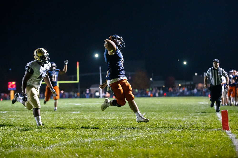 Rochester quarterback Nic Baker (8) goes in for the touchdown against Belleville Althoff's Nyge Watts (44) in the second half during the second round of the IHSA Class 4A Playoffs at Rocket Booster Stadium, Saturday, Nov. 4, 2017, in Rochester, Ill. [Justin L. Fowler/The State Journal-Register]