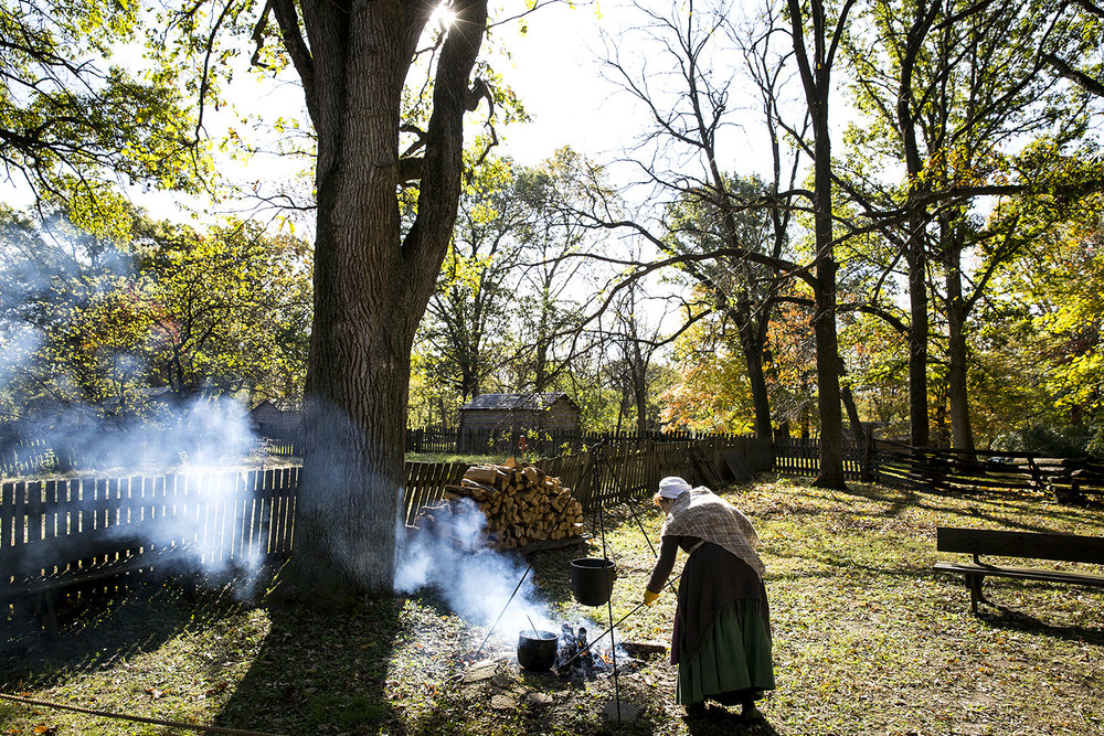 Jane Carrington tends the fire while she renders a pot of fat for use in making soap Sunday, Oct. 29, 2017 at New Salem State Historic Site's annual Fall Festival. The restored village near Petersburg depicts the period when Abraham Lincoln lived there from 1831-1837. [Rich Saal/The State Journal-Register]