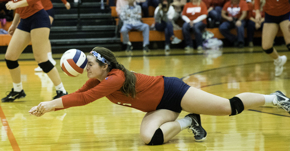 Pleasant Plains' Jade Garett dives for a dig against Quincy Notre Dame  during the Class 2A New Berlin Sectional volleyball championship Wednesday, Nov. 1, 2017.  [Ted Schurter/The State Journal-Register]