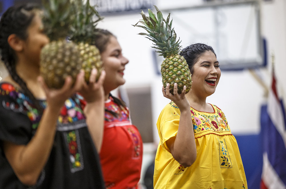 University of Illinois Springfield freshman Angelina Gudino, right, performs the Pineapple Flower Dance with the Organization of Latin American Students during UIS's 40th annual International Festival at The Recreation and Athletic Center, Friday, Nov. 3, 2017, in Springfield, Ill. The event is the longest running student-led program for the university hand featured cultural exhibits, food tasting and artistic performances from around the globe. [Justin L. Fowler/The State Journal-Register]