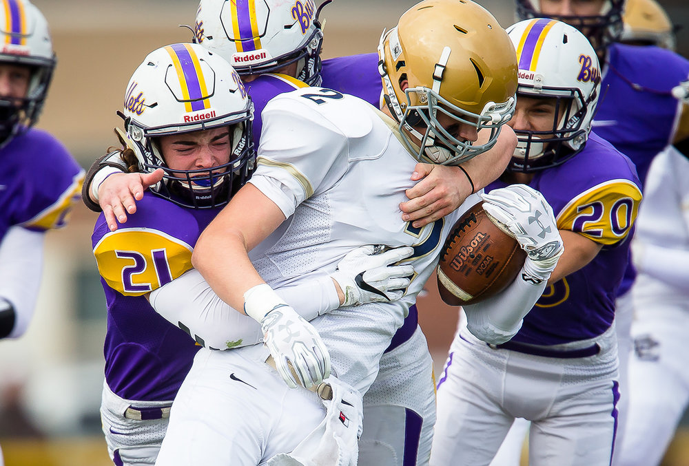 Williamsville's Cade Beckett (21) brings down Bloomington Central Catholic's Jack Moews (2) after a catch in the first quarter during the second round of the IHSA Class 3A Playoffs at Paul Jenkins Field, Saturday, Nov. 4, 2017, in Williamsville, Ill. [Justin L. Fowler/The State Journal-Register]