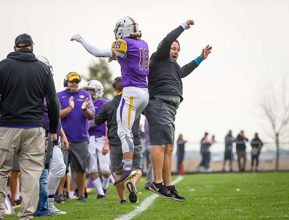 Williamsville's Bryan Rapp (18) celebrates with the coaches on the sidelines after a Bullets touchdown against Bloomington Central Catholic in the second quarter during the second round of the IHSA Class 3A Playoffs at Paul Jenkins Field, Saturday, Nov. 4, 2017, in Williamsville, Ill. [Justin L. Fowler/The State Journal-Register]