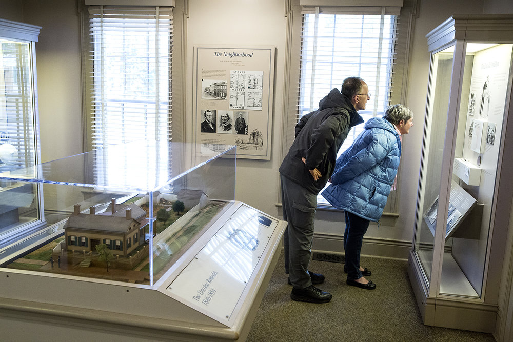 Ken Frick and Cindy McKay, visiting from Columbus, Ohio, view exhibits in the Harriet Dean House in the Lincoln Home National Historic Site Monday, Oct. 30, 2017. The house is open again after a 6-month renovation for exterior repairs including a new roof, gutters and paint. In 1850, Dean, whose house is across the street from the Lincoln Home, purchased some of the land it sits on from Lincoln. Exhibits in the house depict the life of the future president during the 17 years he lived in Springfield. [Rich Saal/The State Journal-Register]