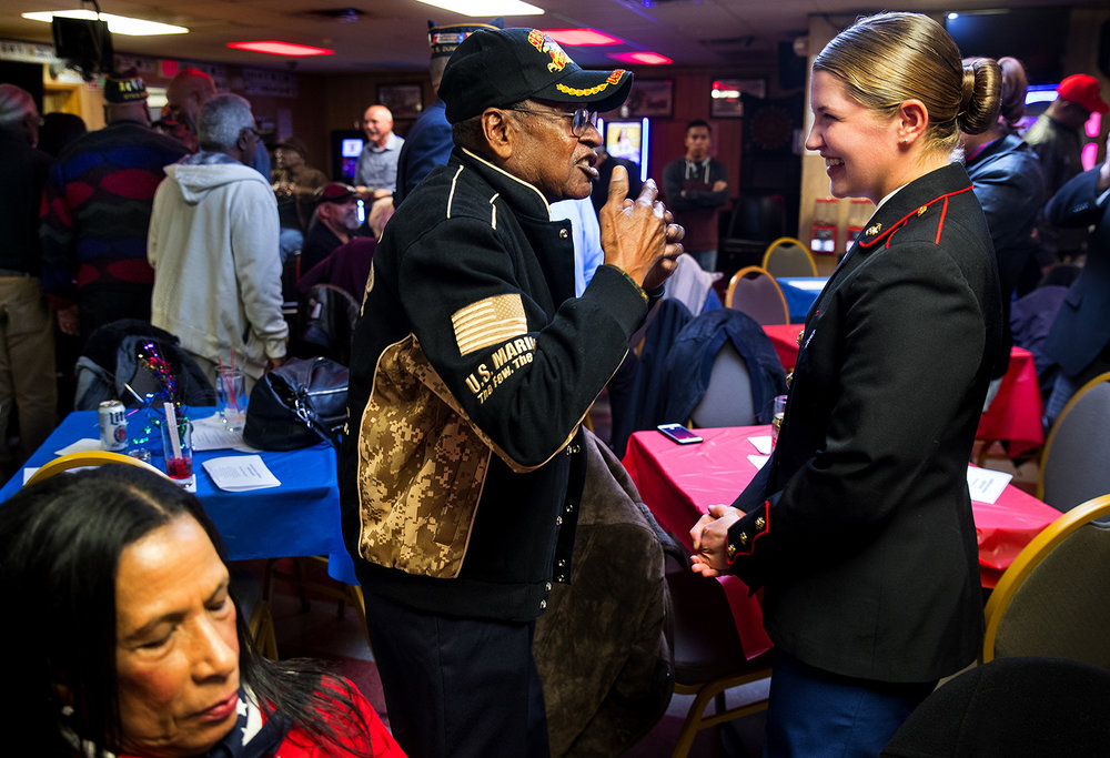 The oldest Marine in attendance during the Mayor's Veterans Reception at American Legion Post 809, World War II veteran Leon Carter, visits with the youngest, newly minted Marine Lorna Scheuermann Friday, Nov. 10, 2017. Mayor Jim Langfelder made brief remarks during the event. [Ted Schurter/The State Journal-Register]