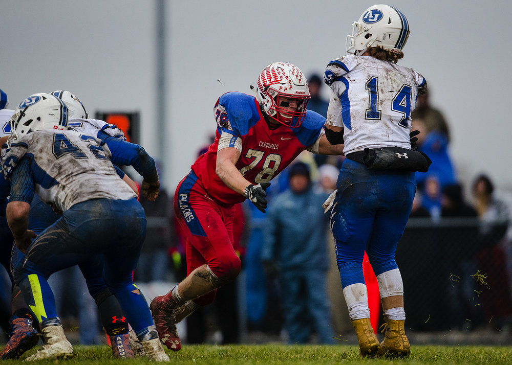 Pleasant Plains' Ethan Ankenbrandt closes in on Anna-Jonesboro's Bryce Osman during the IHSA Class 3A football semifinal game at Pleasant Plains High School Saturday, Nov. 18, 2017. [Ted Schurter/The State Journal-Register]