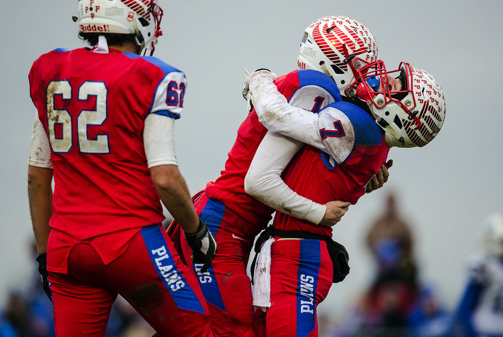 Pleasant Plains' Kai Carlberg (7) celebrates with Pleasant Plains' Nick Sunley in the second half during the IHSA Class 3A football semifinal game at Pleasant Plains High School Saturday, Nov. 18, 2017. [Ted Schurter/The State Journal-Register]