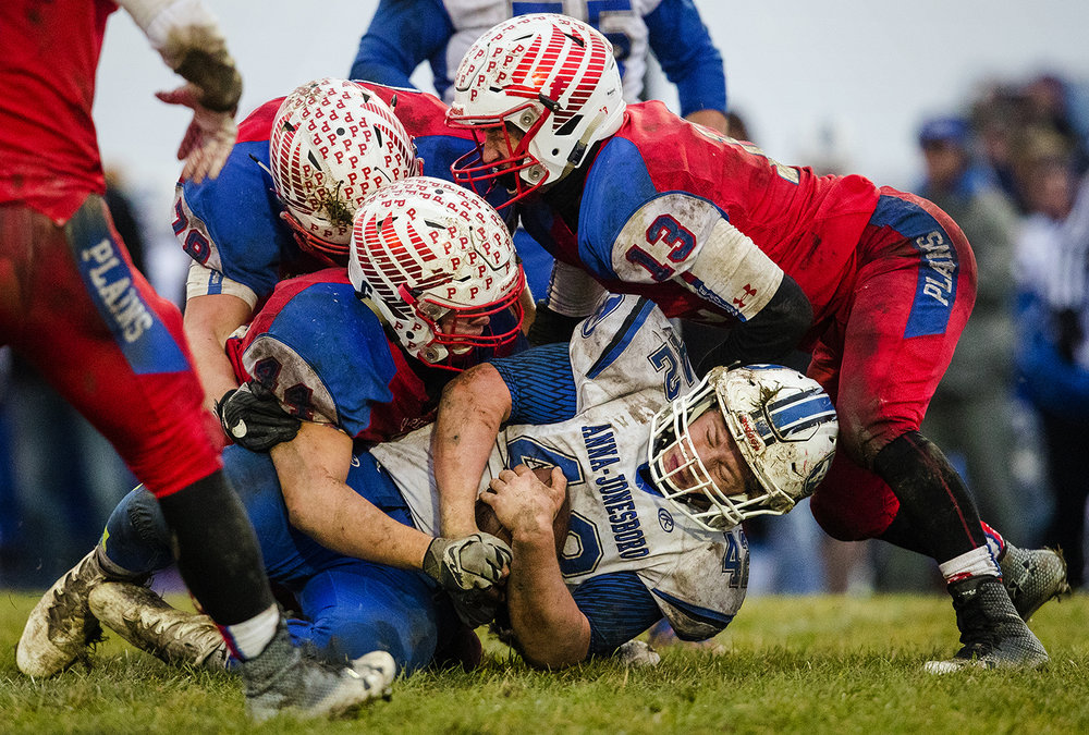 Pleasant Plains defenders pile on Anna-Jonesboro's Jayce Turner during the IHSA Class 3A football semifinal game at Pleasant Plains High School Saturday, Nov. 18, 2017. [Ted Schurter/The State Journal-Register]