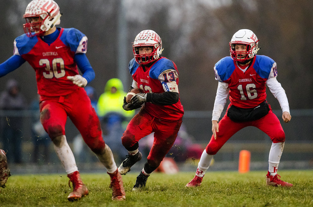 Pleasant Plains' Lucas Western takes a handoff and looks upfield during the IHSA Class 3A football semifinal game at Pleasant Plains High School Saturday, Nov. 18, 2017. [Ted Schurter/The State Journal-Register]