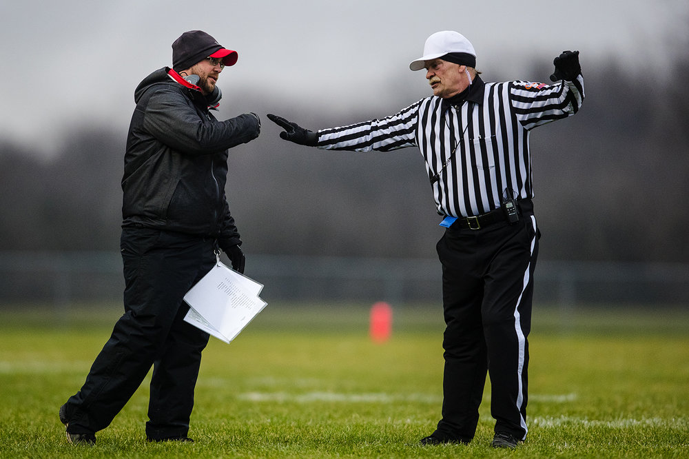 Pleasant Plains' head coach Brody Walworth talks with an official in the second half during the IHSA Class 3A football semifinal game at Pleasant Plains High School Saturday, Nov. 18, 2017. [Ted Schurter/The State Journal-Register]