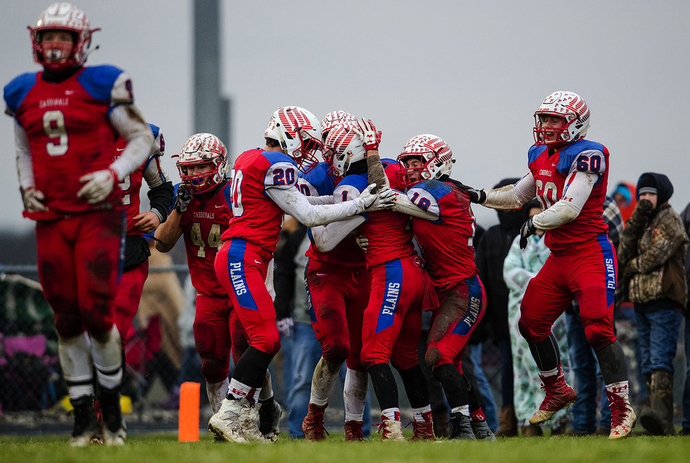 Pleasant Plains' Nick Sunley is mobbed by his teammates after a second half touchdown against Anna-Jonesboro during the IHSA Class 3A football semifinal game at Pleasant Plains High School Saturday, Nov. 18, 2017. [Ted Schurter/The State Journal-Register]