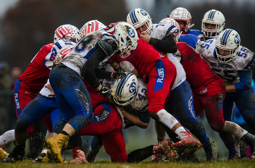 Anna-Jonesboro's Jayce Turner (42) is stopped in the middle of a pile-up during the IHSA Class 3A football semifinal game at Pleasant Plains High School Saturday, Nov. 18, 2017. [Ted Schurter/The State Journal-Register]