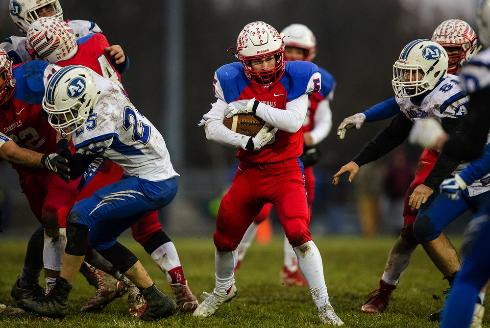 Pleasant Plains' Alec Mudra finds a hole in the line against Anna-Jonesboro during the IHSA Class 3A football semifinal game at Pleasant Plains High School Saturday, Nov. 18, 2017. [Ted Schurter/The State Journal-Register]