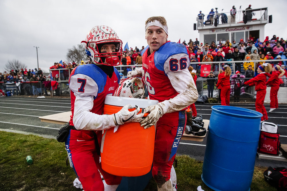 Pleasant Plains' Kai Carlberg and Griffin Tebrugge grab the cooler of water to dump on Pleasant Plains' head coach Brody Walworth as time winds down in their 41-2 win against Anna-Jonesboro during the IHSA Class 3A football semifinal game at Pleasant Plains High School Saturday, Nov. 18, 2017. [Ted Schurter/The State Journal-Register]
