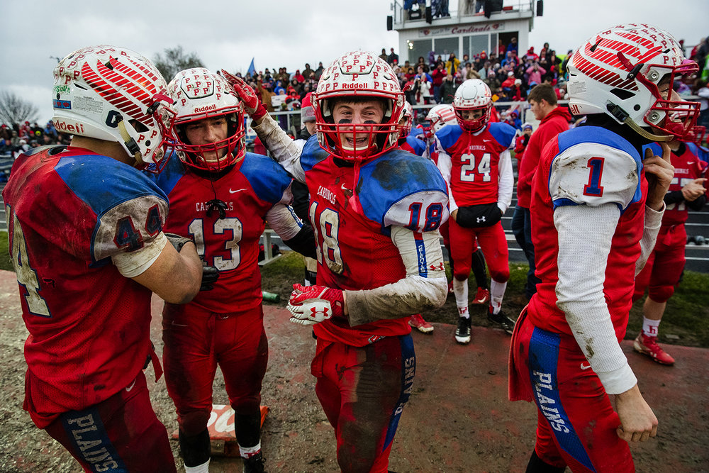 Pleasant Plains' Nik Samson, left, Lucas Western and Kevin Ingram congratulate each other as time winds down on the IHSA Class 3A football semifinal game at Pleasant Plains High School Saturday, Nov. 18, 2017. [Ted Schurter/The State Journal-Register]
