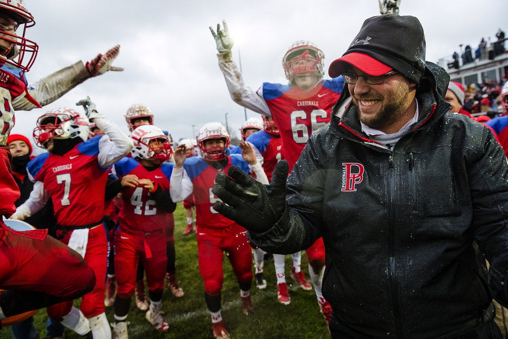 Pleasant Plains' head coach Brody Walworth laughs with his team after they doused him with water at the end of the IHSA Class 3A football semifinal game at Pleasant Plains High School Saturday, Nov. 18, 2017. Plains defeated Anna-Jonesboro to advance to the championship game for the first time in school history. [Ted Schurter/The State Journal-Register]