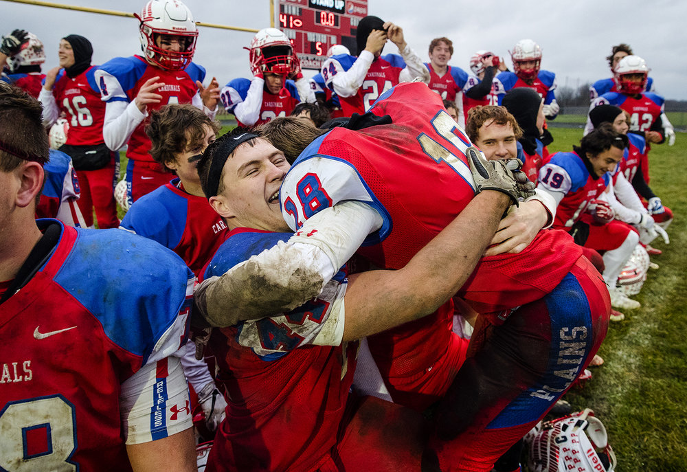 Pleasant Plains' Nik Samson embraces Pleasant Plains' Kevin Ingram as they celebrate their win against Anna-Jonesboro during the IHSA Class 3A football semifinal game at Pleasant Plains High School Saturday, Nov. 18, 2017. [Ted Schurter/The State Journal-Register]