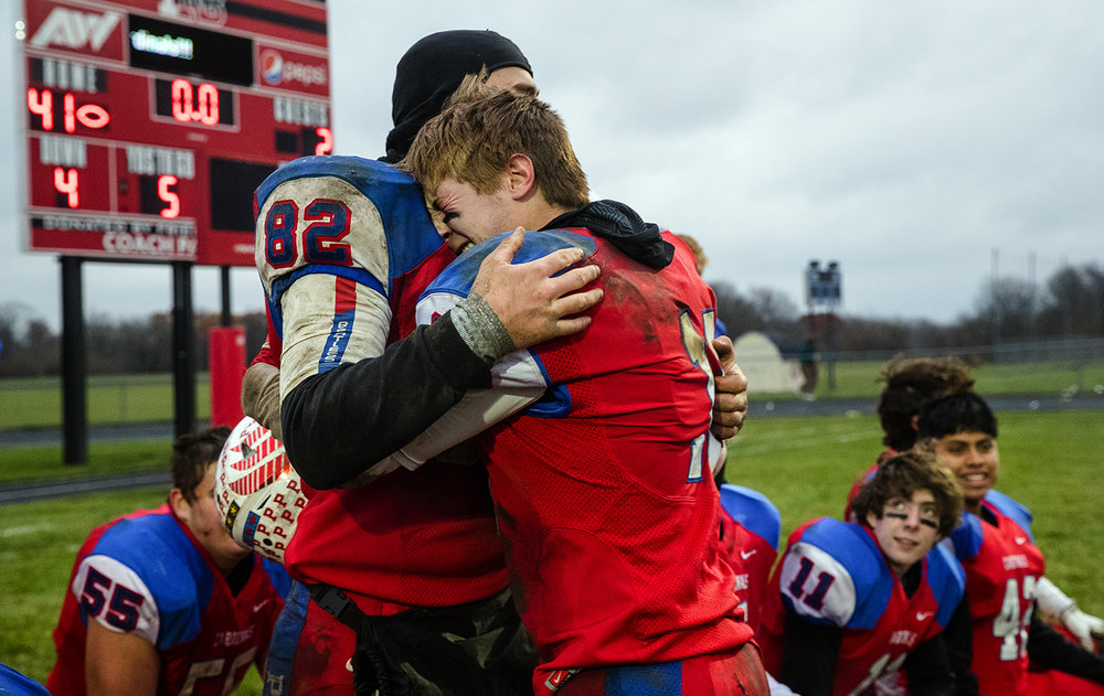 Pleasant Plains' Tristen Tewes and Kevin Ingram celebrate their win against Anna-Jonesboro during the IHSA Class 3A football semifinal game at Pleasant Plains High School Saturday, Nov. 18, 2017. [Ted Schurter/The State Journal-Register]