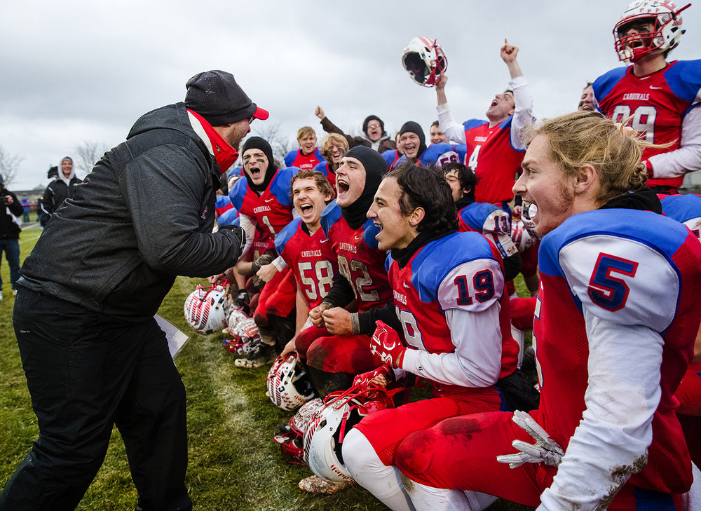 Pleasant Plains' head coach Brody Walworth celebrates with the Cardinals after their 41-2 win against Anna-Jonesboro during the IHSA Class 3A football semifinal game at Pleasant Plains High School Saturday, Nov. 18, 2017. [Ted Schurter/The State Journal-Register]
