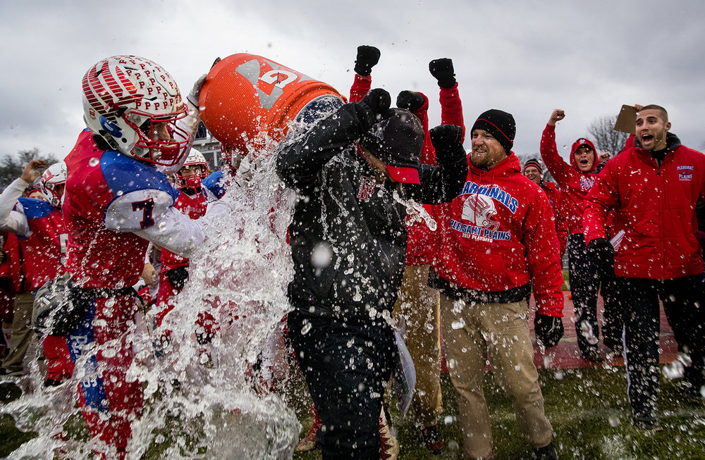 Pleasant Plains' Kai Carlberg douses Pleasant Plains' head coach Brody Walworth with a bucket of water as time expires during their IHSA Class 3A football semifinal victory against Anna-Jonesboro at Pleasant Plains High School Saturday, Nov. 18, 2017. [Ted Schurter/The State Journal-Register]