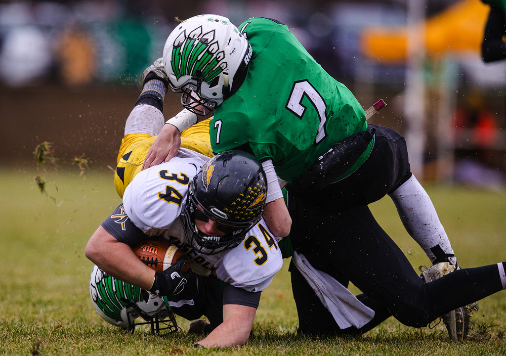Tuscola's Andrew Erickson plows into Athens' Drayton Davis in the first half during the IHSA Class 1A football semifinal game at the Athens Sports Complex Saturday, Nov. 18, 2017. [Ted Schurter/The State Journal-Register]