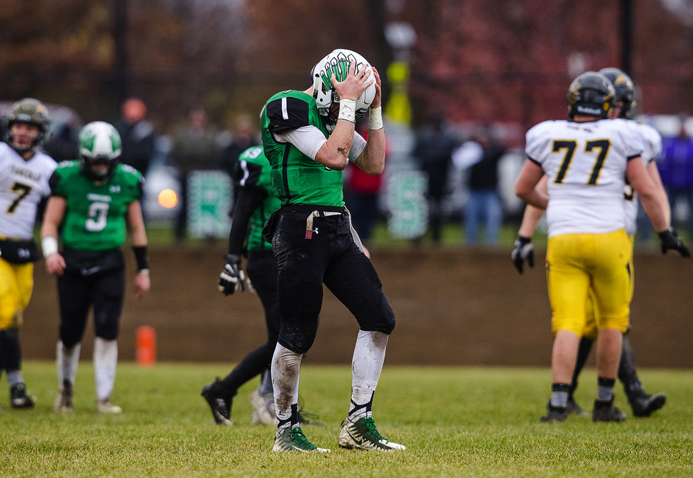 Athens' Drayton Davis holds his head in his hands after missing an interception against Tuscola during the IHSA Class 1A football semifinal game at the Athens Sports Complex Saturday, Nov. 18, 2017. [Ted Schurter/The State Journal-Register]