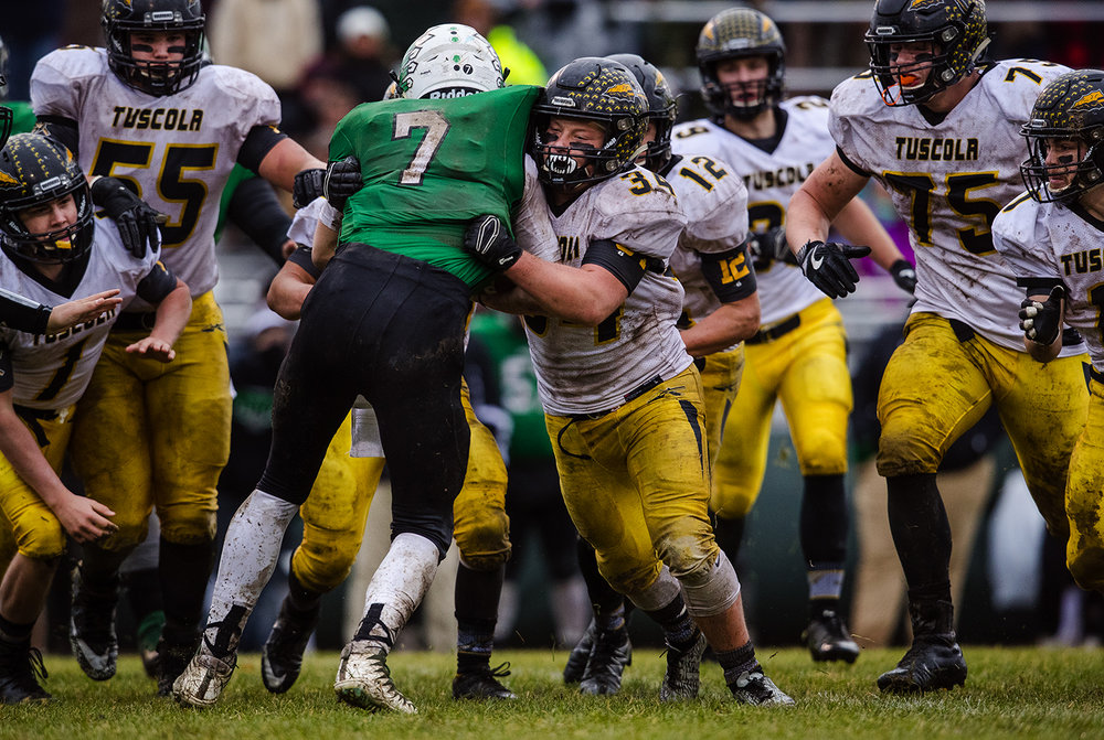 Tuscola's Andrew Erickson stops Athens' Drayton Davis in the first half during the IHSA Class 1A football semifinal game at the Athens Sports Complex Saturday, Nov. 18, 2017. [Ted Schurter/The State Journal-Register]