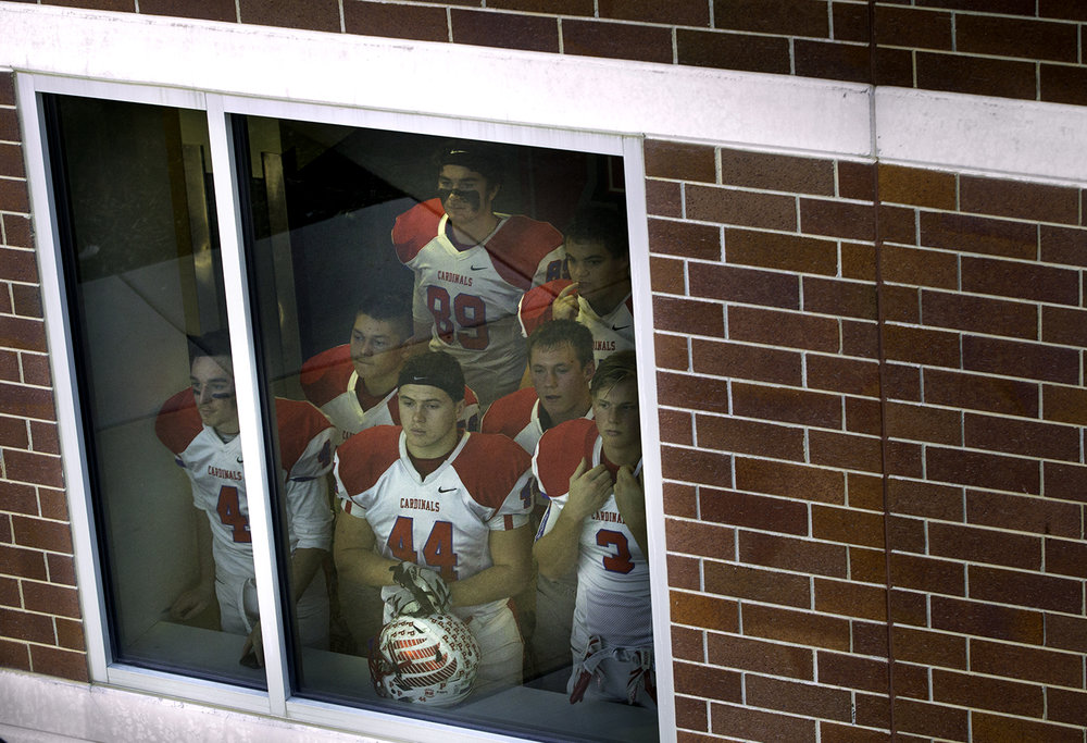 The Pleasant Plains Cardinals watch out the window as they wait for their Class 3A football championship game to begin at Huskie Stadium in Dekalb Friday, Nov. 24, 2017. [Ted Schurter/The State Journal-Register]