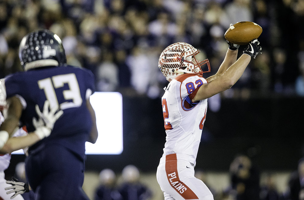 Pleasant Plains' Tristen Tewes grabs a pass in the first half against IC Catholic during the IHSA Class 3A championship game at Huskie Stadium in Dekalb, Ill., Friday, Nov. 24, 2017.   [Ted Schurter/The State Journal-Register]
