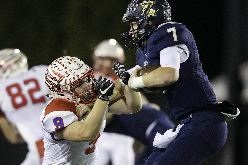 IC Catholic's CJ West stiff arms Pleasant Plains' Jake Hermes during the IHSA Class 3A championship game at Huskie Stadium in Dekalb, Ill., Friday, Nov. 24, 2017.   [Ted Schurter/The State Journal-Register]
