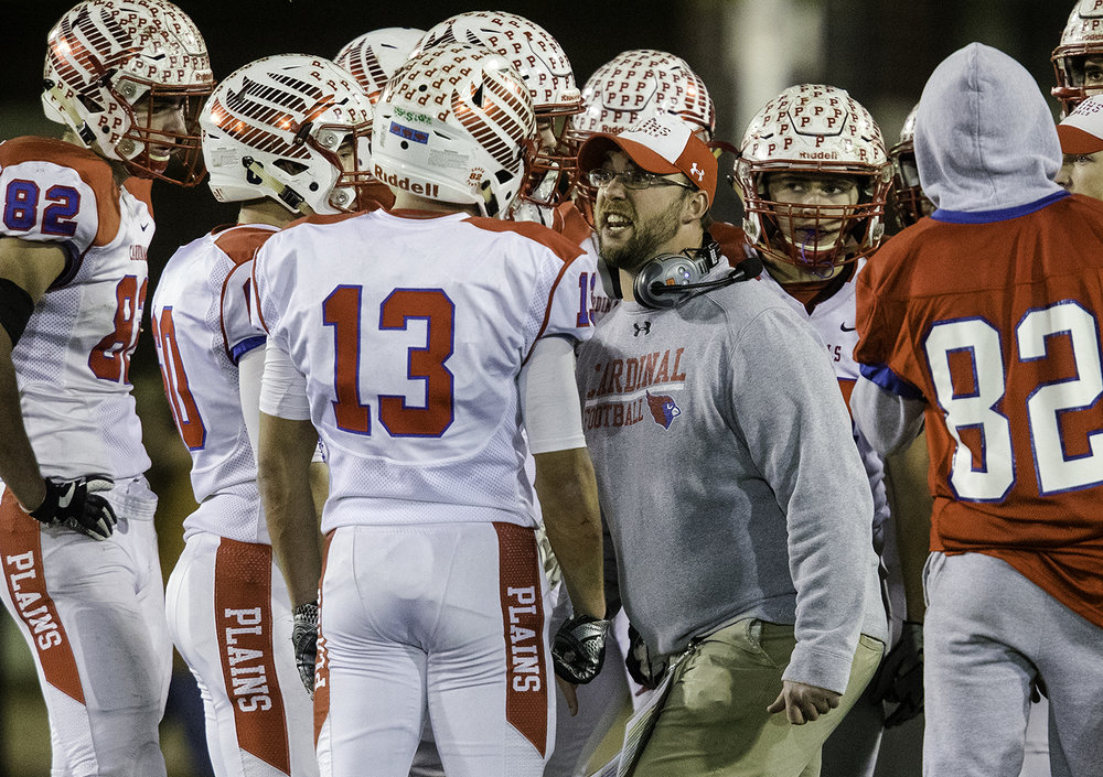 Pleasant Plains head coach Brody Walworthp talks to the team during a second half timeout during the IHSA Class 3A championship game at Huskie Stadium in Dekalb, Ill., Friday, Nov. 24, 2017.   [Ted Schurter/The State Journal-Register]