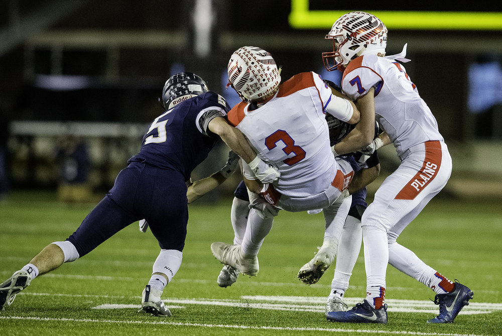Pleasant Plains' Zach Ely is brought down by IC Catholic defenders during the IHSA Class 3A championship game at Huskie Stadium in Dekalb, Ill., Friday, Nov. 24, 2017.   [Ted Schurter/The State Journal-Register]