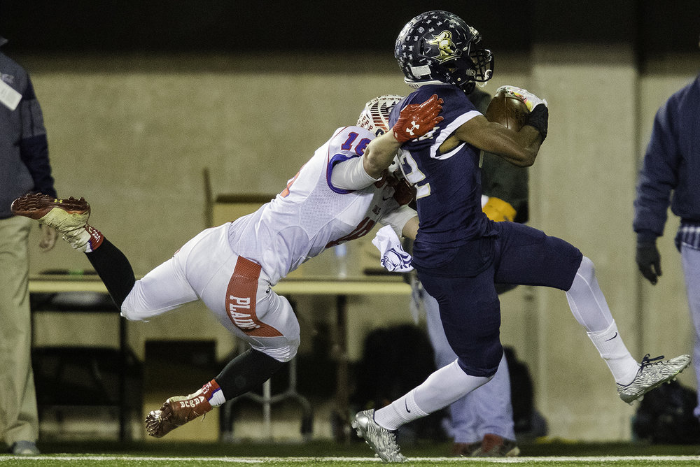 Pleasant Plains' Kevin Ingram dives for IC Catholic's Lazerick Eatman during the IHSA Class 3A championship game at Huskie Stadium in Dekalb, Ill., Friday, Nov. 24, 2017.   [Ted Schurter/The State Journal-Register]