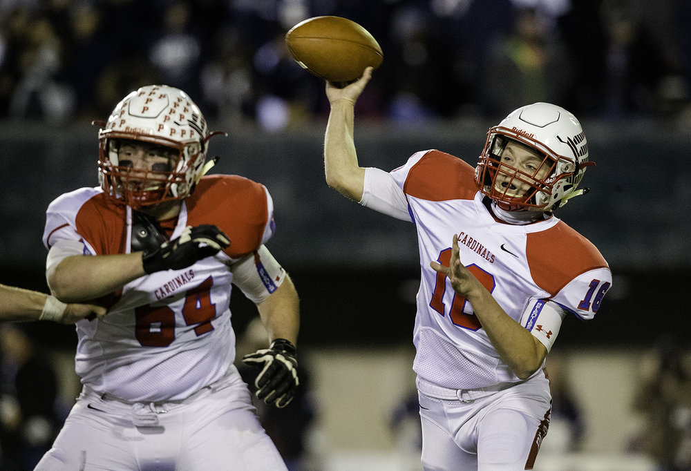 Pleasant Plains' Ben Reinert fires a pass against IC Catholic during the IHSA Class 3A championship game at Huskie Stadium in Dekalb, Ill., Friday, Nov. 24, 2017.   [Ted Schurter/The State Journal-Register]