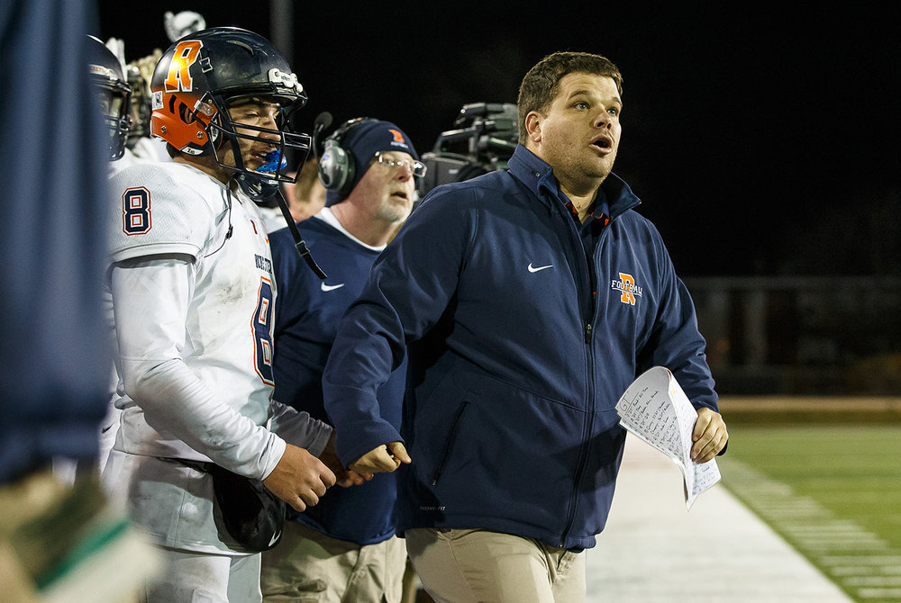 Rochester head football coach Derek Leonard and Rochester quarterback Nic Baker (8) watch the final kick to give the Rockets a 24-21 victory over Morris in the IHSA Class 4A State Championship at Huskie Stadium, Friday, Nov. 24, 2017, in Dekalb, Ill. [Justin L. Fowler/The State Journal-Register]