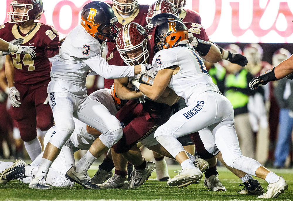 Rochester's David Allen (3) and Rochester's Cade Eddington (6) combine to bring down Morris' Kameron Dransfeldt (7) in the third quarter during the IHSA Class 4A State Championship at Huskie Stadium, Friday, Nov. 24, 2017, in Dekalb, Ill. [Justin L. Fowler/The State Journal-Register]