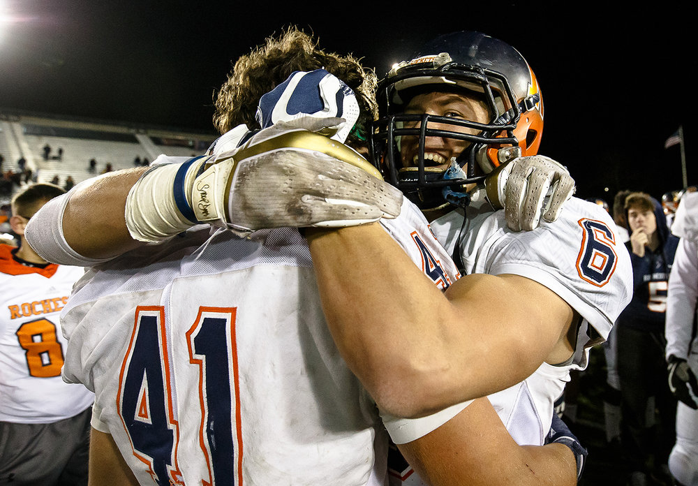 Rochester's Cade Eddington (6) celebrates with Rochester's Nick Capriotti (41) after the Rockets defeated Morris 24-21 in the IHSA Class 4A State Championship at Huskie Stadium, Friday, Nov. 24, 2017, in Dekalb, Ill. [Justin L. Fowler/The State Journal-Register]