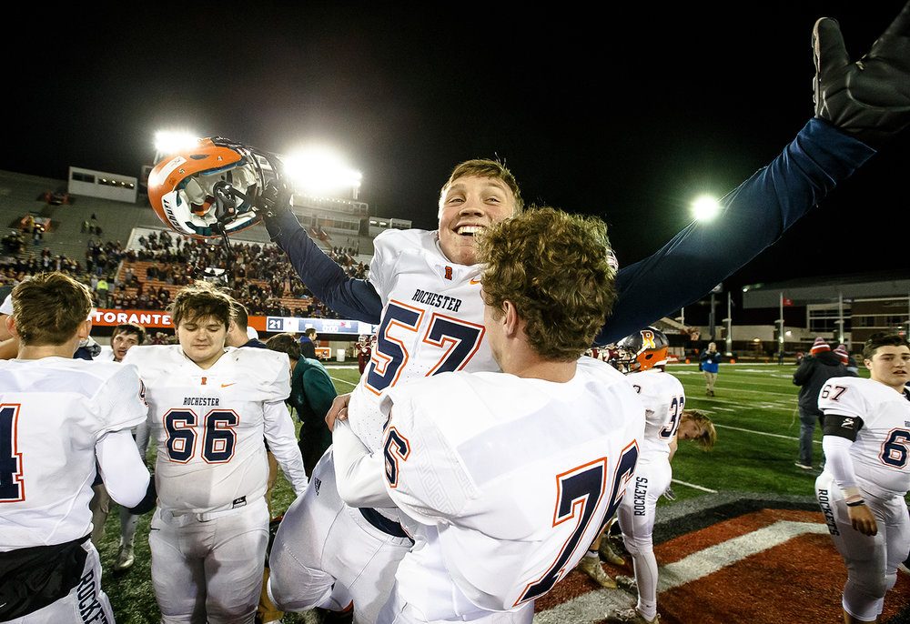 Rochester's Josh Scranton (57) is hoisted up by his teammate as the Rockets celebrate defeating Morris 24-21 in the IHSA Class 4A State Championship at Huskie Stadium, Friday, Nov. 24, 2017, in Dekalb, Ill. [Justin L. Fowler/The State Journal-Register]